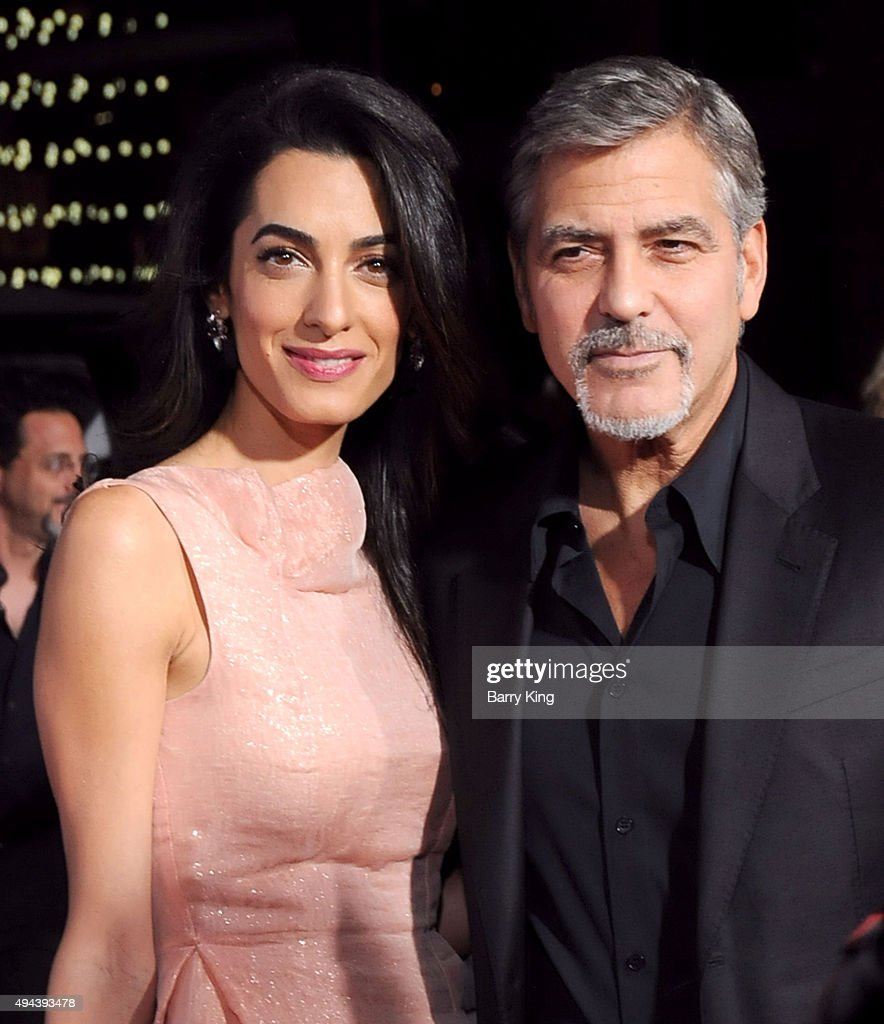 Lawyer Amal Alamuddin Clooney and actor/producer George Clooney arrive at the premiere of Warner Bros. Pictures' 'Our Brand Is Crisis' at TCL Chinese Theatre on October 26, 2015 in Hollywood, California.