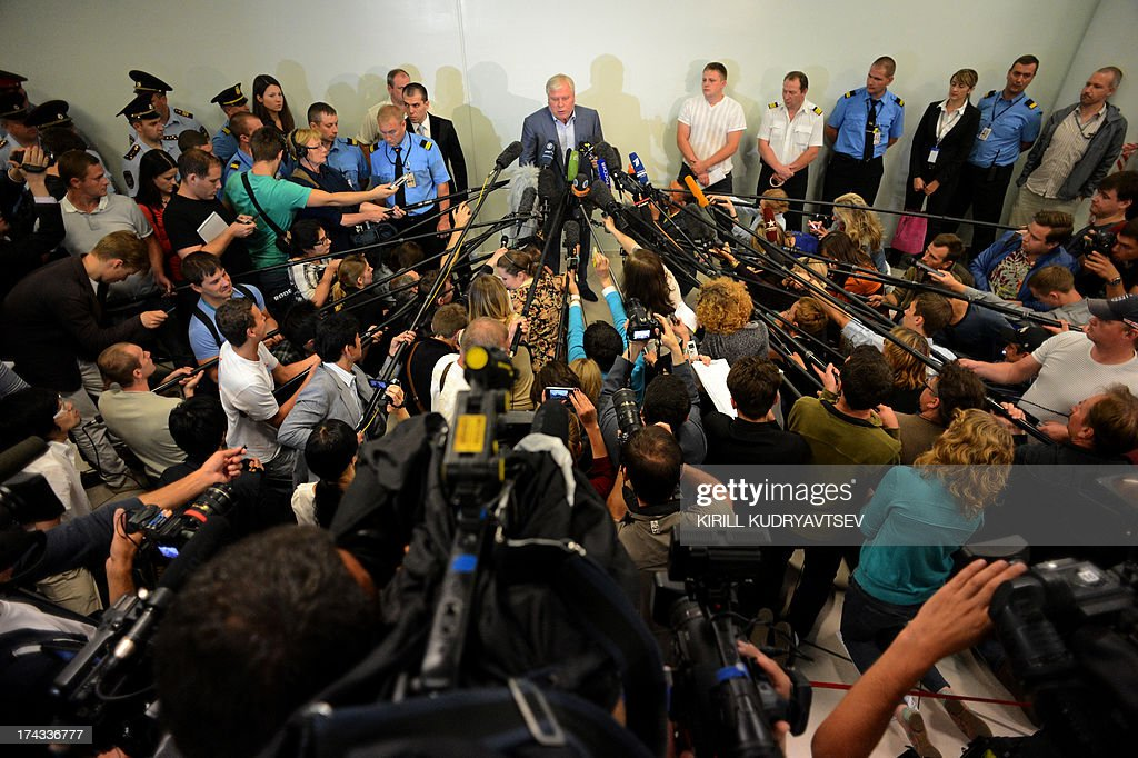 Lawyer Anatoly Kucherena (C) speaks with journalists inside the terminal F of Moscow's Sheremetyevo airport, on July 24, 2013, after his meeting with US National Security Agency (NSA) fugitive leaker Edward Snowden. The Russian lawyer helping Edward Snowden said Wednesday he would give the US fugitive a copy of Fyodor Dostoyevsky's novel 'Crime and Punishment' as he prepares to leave the Moscow airport where he has been holed up for a month.