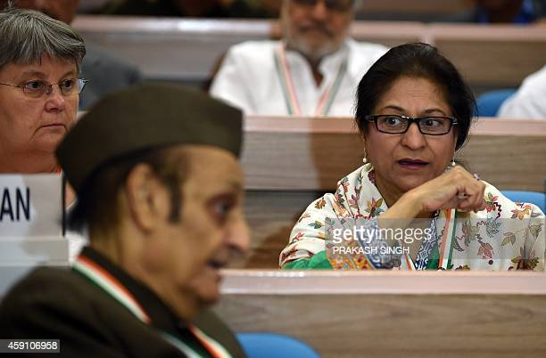 Lawyer and Human Right Activist from Pakistan Asma Jahangir talks with Congress Party Leader Karan Singh during the inauguration of twoday...