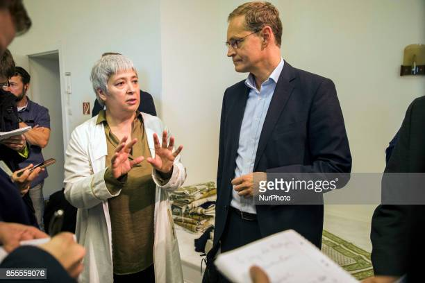 Lawyer and women right activist Seyran Ates and Berlin's Mayor Michael Mueller speak with journalists during his visit to the liberal Ibn...