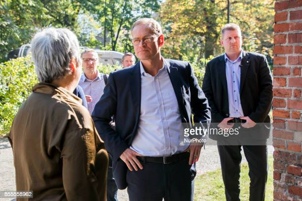 Lawyer and women right activist Seyran Ates speaks with Berlin's Mayor Michael Mueller before his visit to the liberal Ibn RushdGoethemosque in...