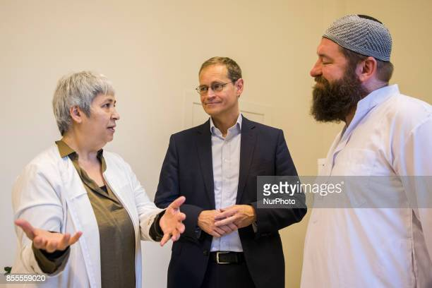 Lawyer and women right activist Seyran Ates speaks with Berlin's Mayor Michael Mueller and community coordinator Avan during his visit to the liberal...