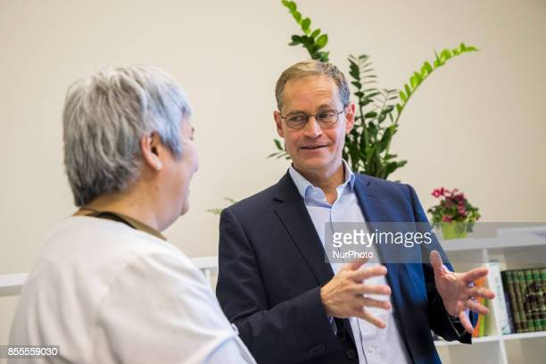 Lawyer and women right activist Seyran Ates speaks with Berlin's Mayor Michael Mueller during his visit to the liberal Ibn RushdGoethemosque in...