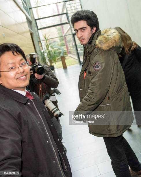 Lawyer ChanJo Jun and the Syrian refugee Anas Modamani arrive for the court session over the lawsuit against Facebook at the Landgericht courthouse...