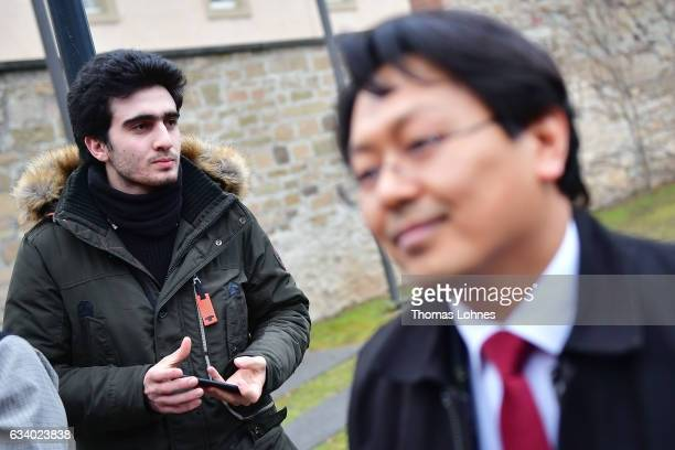 Lawyer ChanJo Jun and the Syrian refugee Anas Modamani pictured after the court session over Modamani's lawsuit against Facebook at the Landgericht...