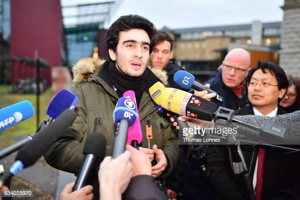 Lawyer ChanJo Jun and the Syrian refugee Anas Modamani speaks to the media after the court session over Modamani's lawsuit against Facebook at the...