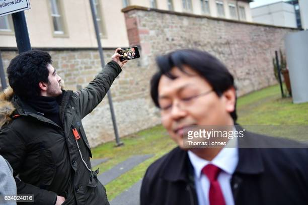 Lawyer ChanJo Jun speaks to the media while the Syrian refugee Anas Modamani takes a selfi photo after the court session over Modamani's lawsuit...