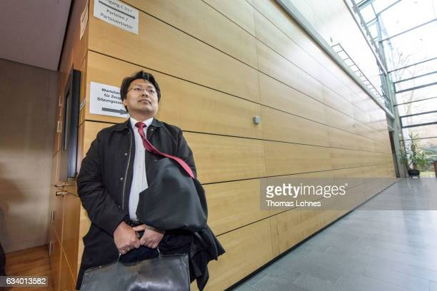 Lawyer ChanJo Jun who is representing Syrian refugee Anas Modamani waits for the beginning of the court session over Modamani's lawsuit against...