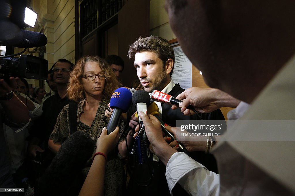 Lawyer David Gaveriaux speaks to the press after the trial of three of his clients at Versailles' Courthouse, near Paris, on July 22, 2013 for having thrown projectiles on Policemen during unrest in the suburban city of Trappes on July 19 evening. The unrest came after police officers carried out an identity check on a full-face veiled woman and her husband. The woman's husband tried to strangle one of the officers during the check according to Versailles' prosecutor.