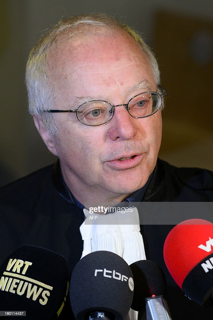 A lawyer defending the Belgian royal family, Alain Berenboom, speaks to journalists on September 9, 2013 at the Court of First Instance in Brussels. Delphine Boel, a 45-year-old artist, has gone to court to win official recognition as the natural daughter of former Belgian King Albert II. Boel's suit has been changed to name only Albert, 79, and her legal father Jacques Boel whose status will be contested so as to help establish her true paternity..