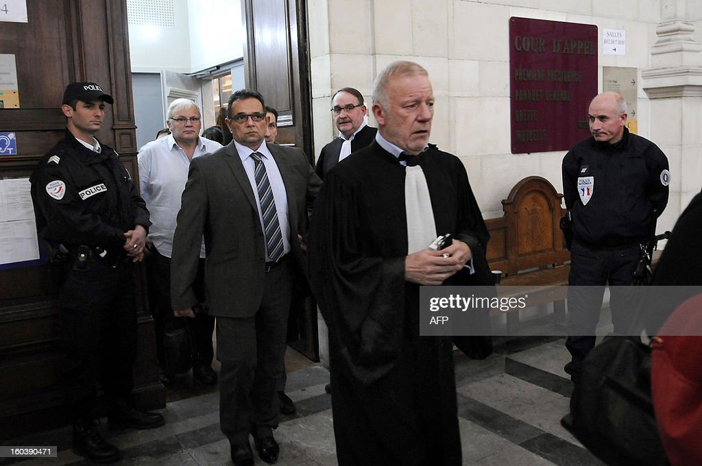 Lawyer Edouard Martial (C) and his client Joel Censier (R), the father of Jeremy Censier killed in 2009, leave the courtroom on January 30, 2013 at the courthouse in Pau, southwestern France, during the trial of six suspects at the criminal court for minors for the killing of Jeremy Censier. The six suspects were under-age when Jeremy Censier, aged 19, was severedly beaten and fatally stabbed during a party in the French southwestern village of Nay, near Pau, during the night of August 21 to 22 2009.