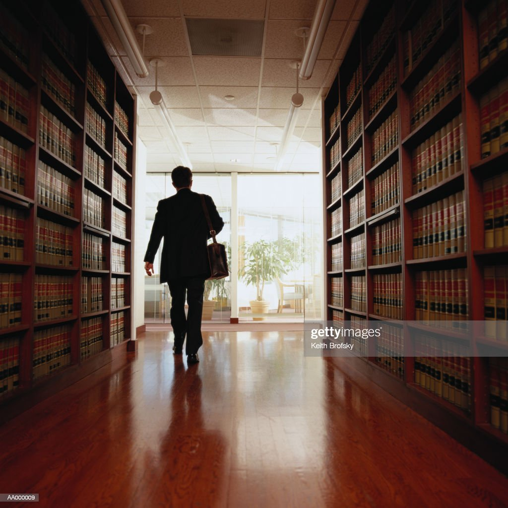 Lawyer Exiting a Law Library