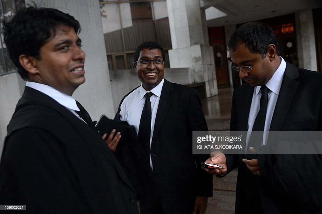Lawyer for the impeached Sri Lankan chief justice Shirani Bandaranayake, Saliya Peiris (C) looks on at the Supreme Court complex in Colombo on January 7, 2013. Sri Lanka's Court of Appeal Monday ordered parliament to drop its impeachment of the country's top judge, amid international concern for judicial independence on the island. AFP POHOTO/ Ishara S