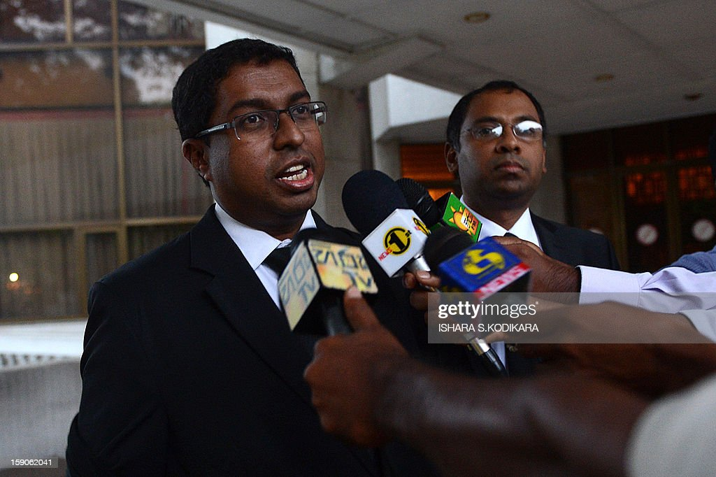 Lawyer for the impeached Sri Lankan chief justice Shirani Bandaranayake, Saliya Peiris (L) speaks with reporters outside the Sri Lankan Supreme Court in Colombo on January 7, 2013. Sri Lanka's Court of Appeal Monday ordered parliament to drop its impeachment of the country's top judge, amid international concern for judicial independence on the island. AFP POHOTO/ Ishara S