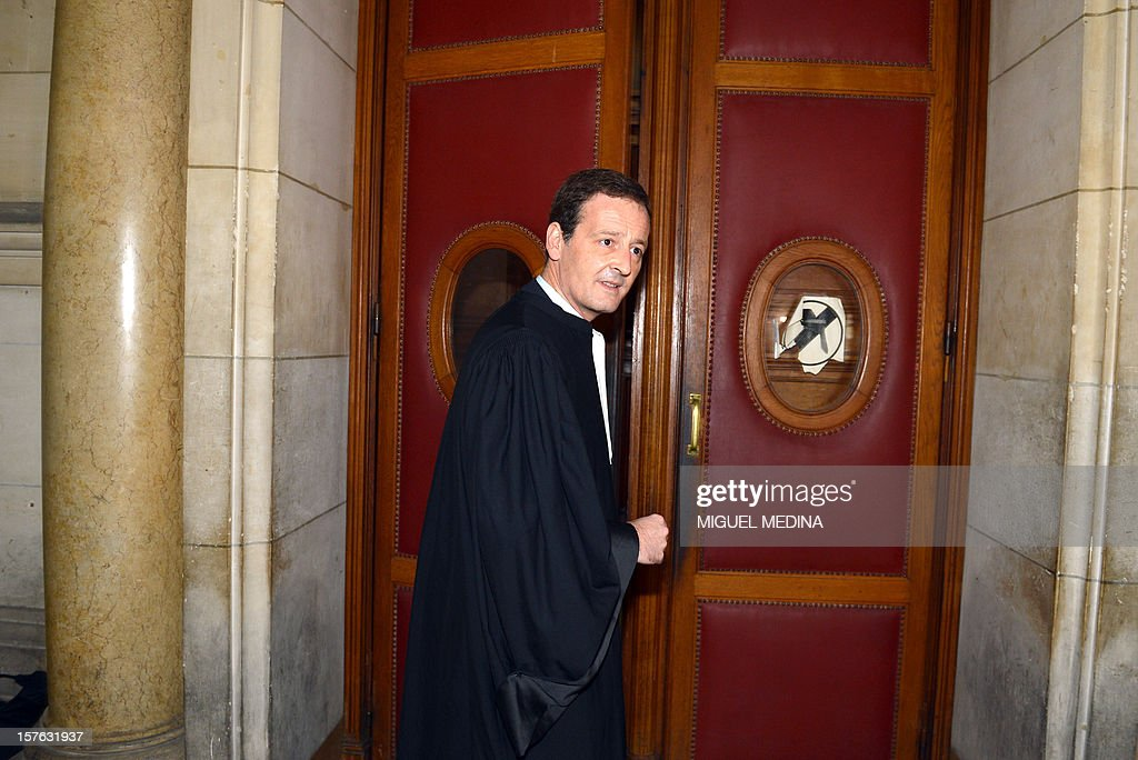 Lawyer Francis Vuillemin enters a courtroom at the Paris courthouse on December 5, 2012 before the trial of 10 suspects charged with extorting funds and associating with mobsters in relation with the January 2011 takeover of the Wagram circle gambling establishment in Paris by people related to alleged gansgsters from the Mediterranean island of Corsica.