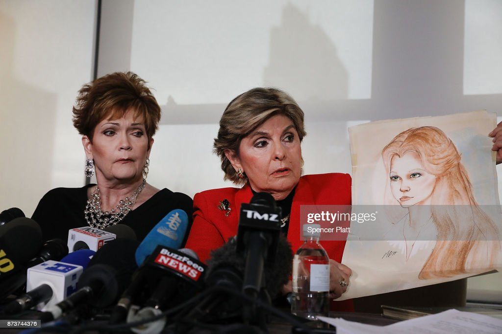 Lawyer Gloria Allred holds up a sketch of Beverly Young Nelson (L) when she was 16, at a news conference where Nelson has accused Alabama Republican Senate candidate Roy Moore of sexually abusing her on November 13, 2017 in New York City. Moore, a controversial politician who recently won a run-off against Luther Strange for Alabama's Senate seat, is currently fighting accusations alleging that he pursued sexual relationships with teenagers -- including a 14-year-old -- when he was in his 30s.