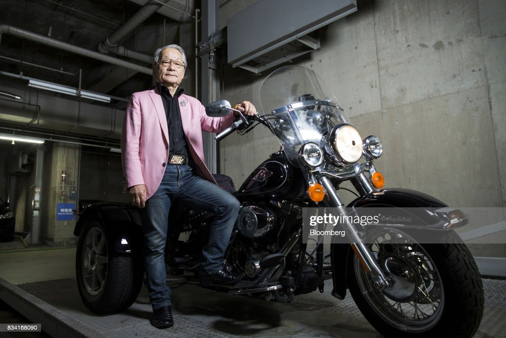 Lawyer Hiroyuki Kawai poses with his Harley-Davidson Inc. Trike motorcycle inside a garage in Tokyo, Japan, on Tuesday, July 25, 2017. Kawaiis propelling the anti-nuclear movement forward with a 22 trillion yen ($171 billion) shareholder lawsuit against Tokyo Electric Power Co. Holdings Inc. (Tepco), among the largest in damages ever sought. Photographer: Tomohiro Ohsumi/Bloomberg via Getty Images