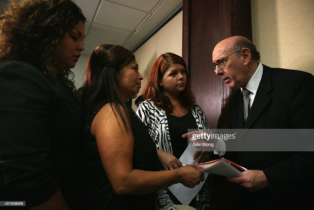 Lawyer <a gi-track='captionPersonalityLinkClicked' href=/galleries/search?phrase=Kenneth+Feinberg&family=editorial&specificpeople=1061876 ng-click='$event.stopPropagation()'>Kenneth Feinberg</a> (R) talks to families of victims of GM vehicle accidents, Laura Christian (3rd L) of Harwood, Maryland, Rosie Cortinas (2nd L) of Caldwell, Idaho, and her daughter Monica Coronado (L) after a news conference June 30, 2014 at the National Press Club in Washington, DC. Feinberg held the news conference to lay out the details of the compensation program he is administrating for General Motors to pay victims and their families that were affected by defective ignition switches installed in 2.6 million GM vehicles.
