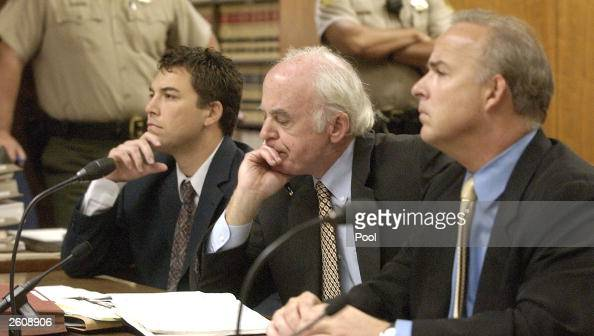 Lawyer Kirk McAllister listens to Judge Al Girolami rulings as defendant Scott Peterson and lawyer Pat Harris from Geragos Geragos sit next to him at...
