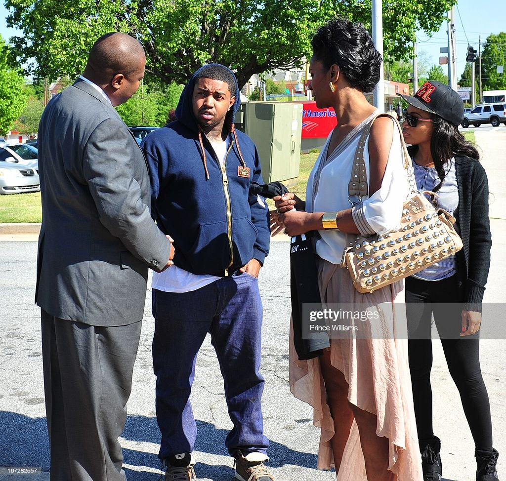 Lawyer, <a gi-track='captionPersonalityLinkClicked' href=/galleries/search?phrase=Lil+Scrappy&family=editorial&specificpeople=775495 ng-click='$event.stopPropagation()'>Lil Scrappy</a>, Mama Dee and Erica Dixon <a gi-track='captionPersonalityLinkClicked' href=/galleries/search?phrase=Lil+Scrappy&family=editorial&specificpeople=775495 ng-click='$event.stopPropagation()'>Lil Scrappy</a> Turns Himself In at Atlanta Police Department on April 23, 2013 in Atlanta, Georgia.