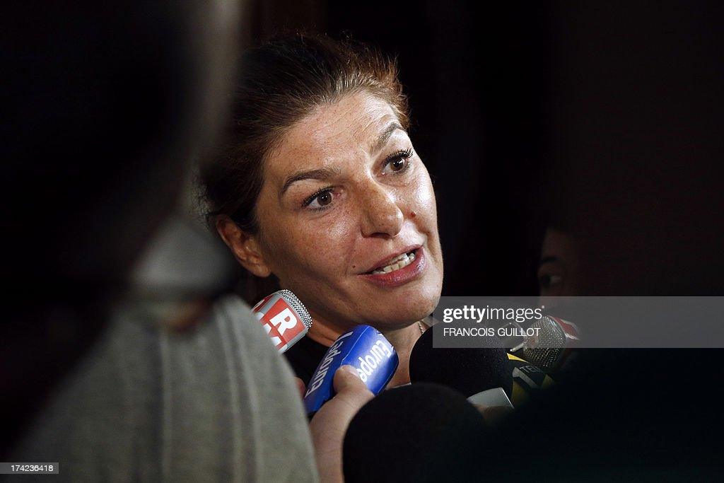 Lawyer Magalie Saligon speaks to the press after the trial of three of her clients at Versailles' Courthouse, near Paris, on July 22, 2013 for having thrown projectiles on Policemen during unrest in the suburban city of Trappes on July 19 evening. The unrest came after police officers carried out an identity check on a full-face veiled woman and her husband. The woman's husband tried to strangle one of the officers during the check according to Versailles' prosecutor. AFP PHOTO / FRANCOIS GUILLOT