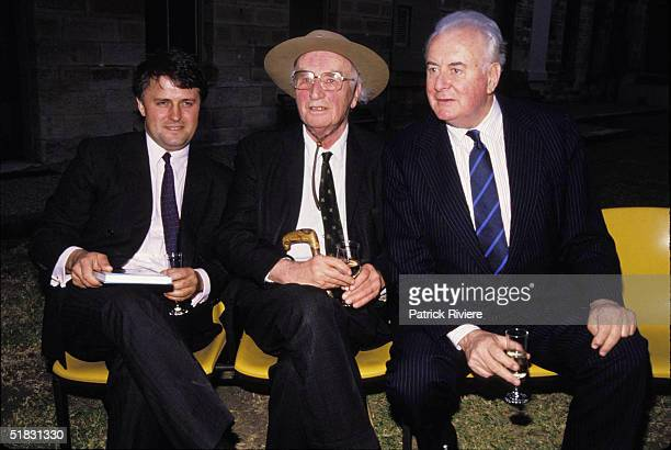 Lawyer Malcolm Turnbull seats with his client former MI5 spy and author Peter Wright and friend and former Australian Prime Minister Gough Whitlam at...