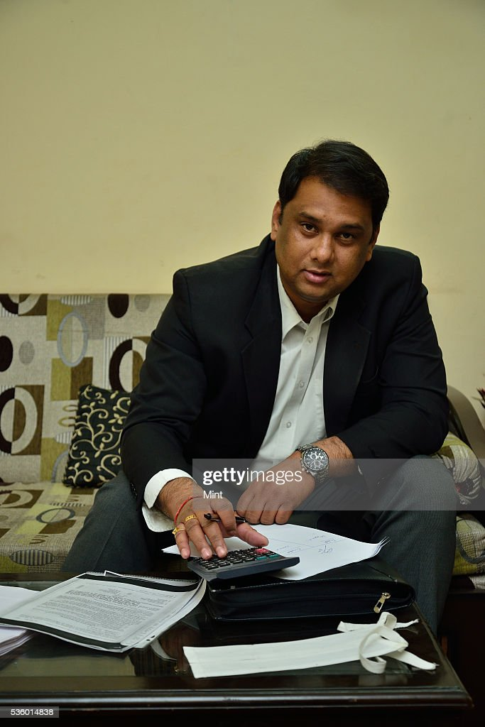 Lawyer Neelesh Sinha poses during an exclusive interview at his home on December 28, 2015 in New Delhi, India.