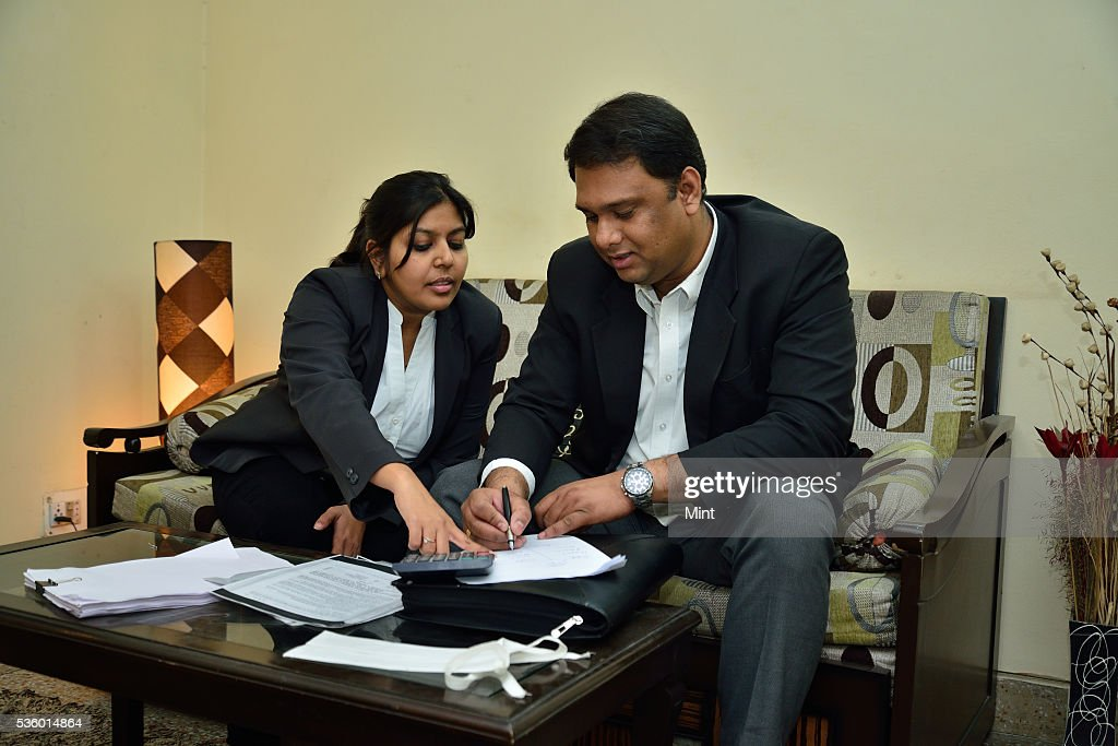 Lawyer Neelesh Sinha poses during an exclusive interview with his wife at home on December 28, 2015 in New Delhi, India.