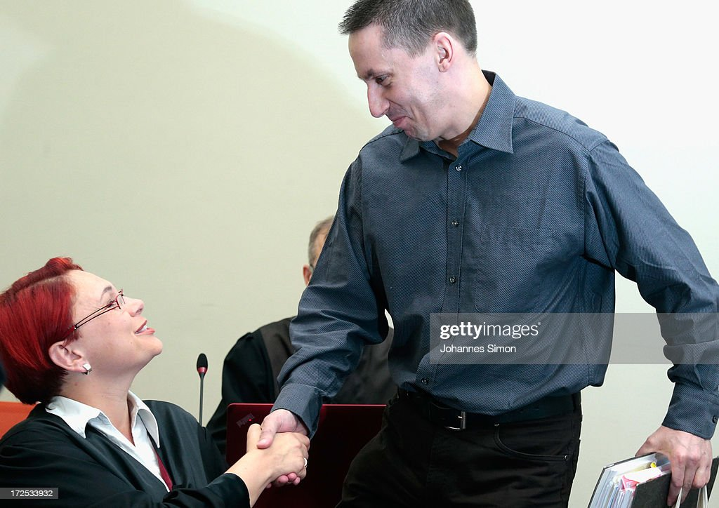 Lawyer Nicole Schneiders (L) welcomes defendant Ralf Wohlleben prior to the trial during day 18 of the NSU neo-Nazis murder trial at the Oberlandgericht Muenchen court on July 3, 2013 in Munich, Germany. Beate Zschaepe is the main defendant and is on trial for her role in assisting Uwe Boehnhardt and Uwe Mundlos in the murder of nine immigrants and one policewoman across Germany between 2000 and 2007. Together the trio called themselves the NSU, or National Socialist Underground, and were able to operate unbeknownst to police until Mundlos and Boehnhardt were cornered in 2011 after the two robbed a bank. Four other co-defendants, including Ralf Wohlleben, Holder G., Carsten S. and Andre E., are accused of assisting the trio. Carsten S. and Holger G. have declared themselves willing to give limited testimonies, while Zschaepe has thus far remained silent and refuses to answer any questions by the court.