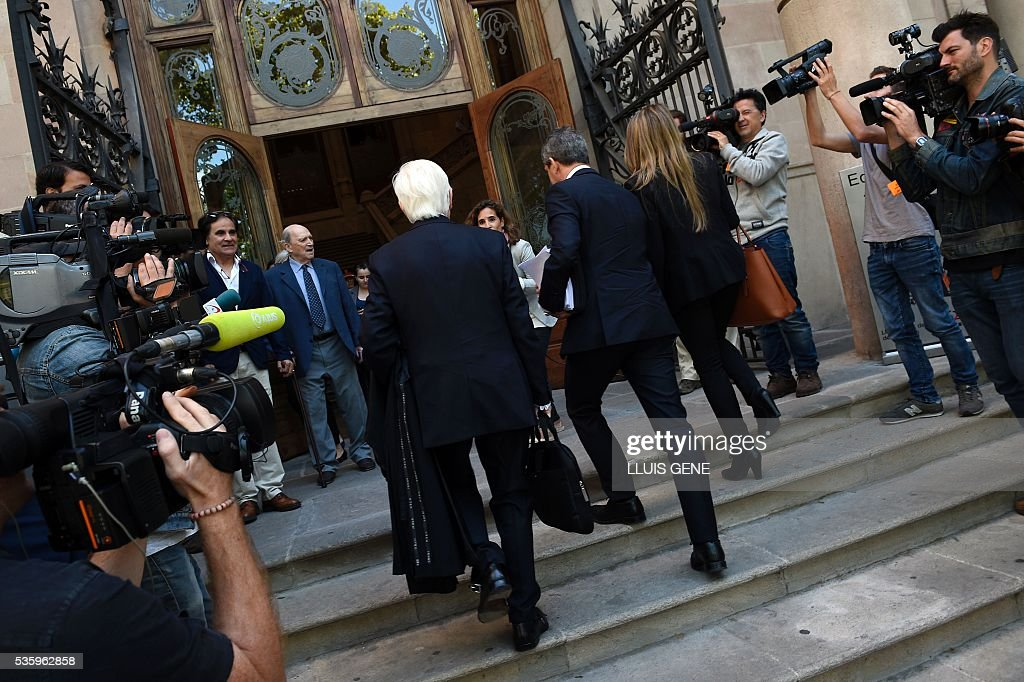 Lawyer of Barcelona football star Lionel Messi, Enrique Bacigalupo (C-L) walks into the courhouse in Barcelona where Messi is to face judges in a tax fraud case. Messi and his father, Jorge Horacio Messi, are accused of using a chain of fake companies in Belize and Uruguay to avoid paying taxes on 4.16 million euros ($4.7 million) of Messi's income earned through the sale of his image rights from 2007-09. GENE