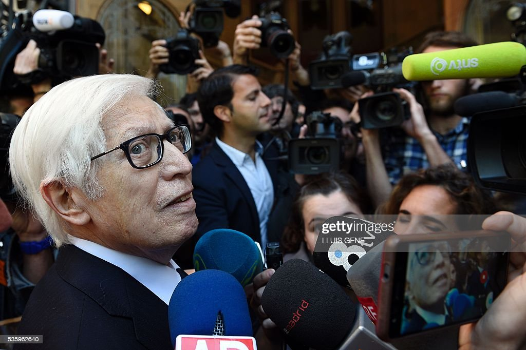 Lawyer of Barcelona football star Lionel Messi, Enrique Bacigalupo (L) talks to the press at the entrance to the courhouse in Barcelona where Messi is to face judges in a tax fraud case. Messi and his father, Jorge Horacio Messi, are accused of using a chain of fake companies in Belize and Uruguay to avoid paying taxes on 4.16 million euros ($4.7 million) of Messi's income earned through the sale of his image rights from 2007-09. GENE