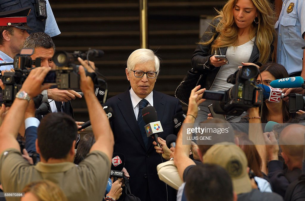Lawyer of Barcelona football star Lionel Messi, Enrique Bacigalupo (C) talks to the press as he leaves the courhouse in Barcelona where Messi is to face judges in a tax fraud case. Messi and his father, Jorge Horacio Messi, are accused of using a chain of fake companies in Belize and Uruguay to avoid paying taxes on 4.16 million euros ($4.7 million) of Messi's income earned through the sale of his image rights from 2007-09. GENE