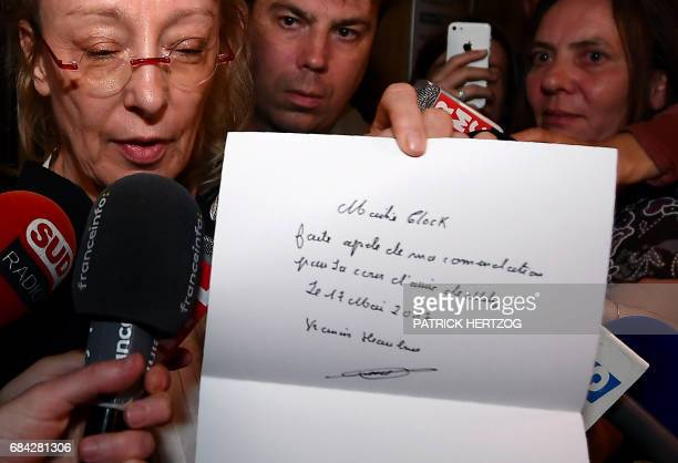 Lawyer of Francis Heaulme Liliane Glock shows a letter written by her client asking her to appeal the court's decision on May 17 2017 at the Assize...