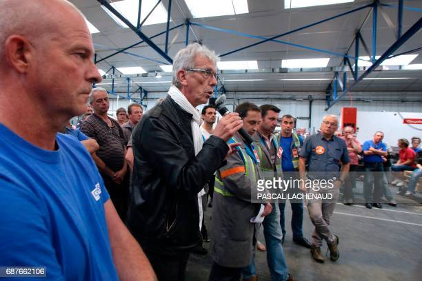Lawyer of workers JeanLouis Borie speaks during a general assembly next to CGT union representatives Patrick Brun Vincent Labrousse and Yann Augras...