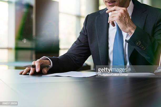 Lawyer preparing to write letter by hand