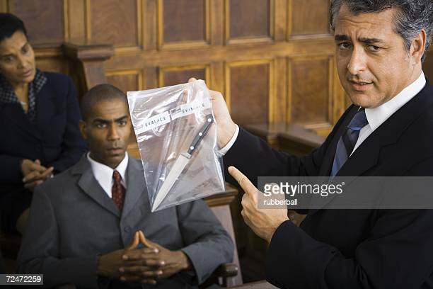 Lawyer presenting evidence to jurors