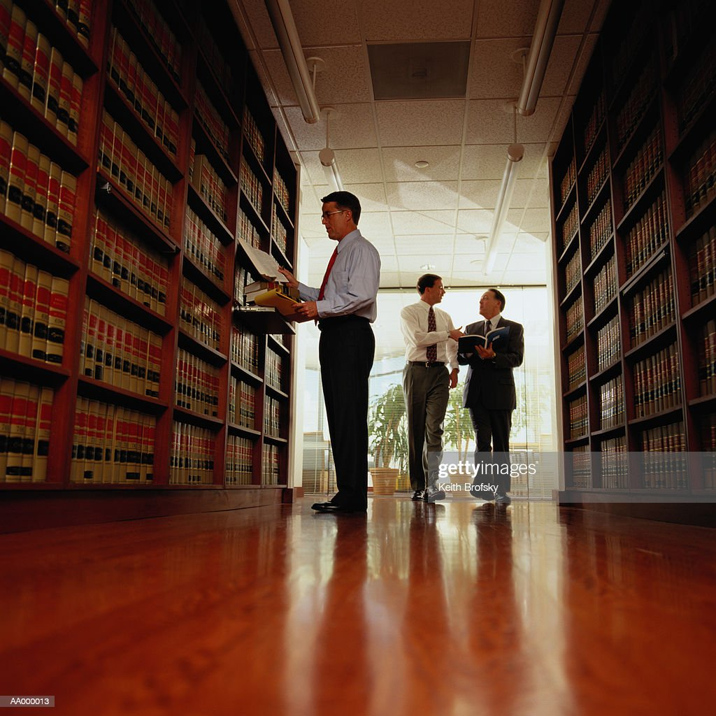 Lawyer Researching Information in a Law Library : Stock Photo