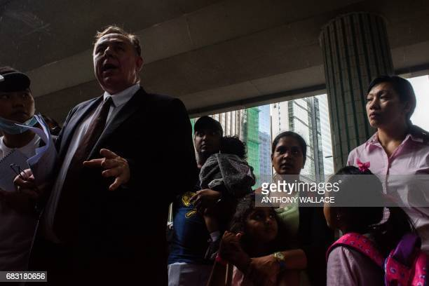 Lawyer Robert Tibbo and his clients Sri Lankan refugee Supun Thilina Kellapatha holding his son Danath his partner Nadeeka her daughter Sethumdi and...