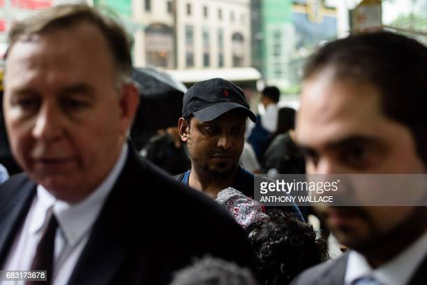Lawyer Robert Tibbo and his colleague MarcAndre Seguin speak during a press conference as Sri Lankan refugee Supun Thilina Kellapatha who helped...