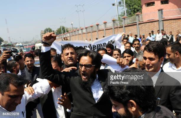 Lawyer shouting slogans against the National Investigation Agency for summoning the Jammu and Kashmir Bar Association president Mian Abdul Qayoom to...