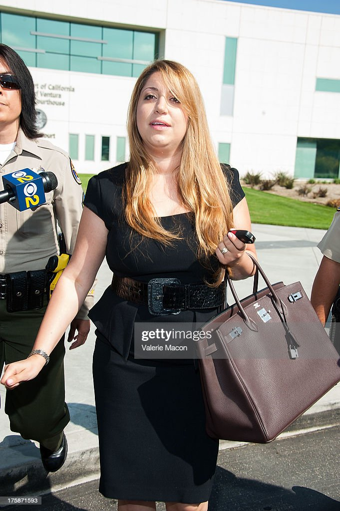 Lawyer Tamar Arminak, the attorney for Amanda Bynes' parents Lynn Bynes and Rick Bynes, departs after a hearing which granted them temporary conservatorship and extended Bynes hospital stay an additional 30 days for psychological treatment August 9, 2013 at the Ventura Superior Court in Oxnard, California. Amanda Bynes has been hospitalized by court order since July 24 after allegedly starting a fire in the driveway of a private residential property.
