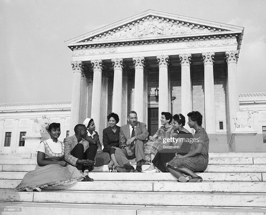 Lawyer Thurgood Marshall and civil rights activist Daisy Bates join several members of the 'Little Rock Nine', the first students to integrate Central High School.