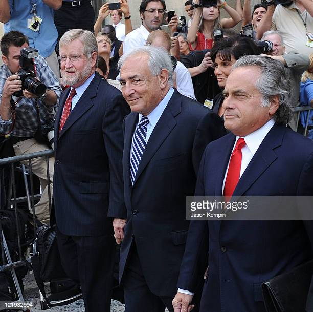 Lawyer William Taylor Dominique StraussKahn and lawyer Benjamin Brafman leave Manhattan Criminal Court after attending a status hearing on the sexual...