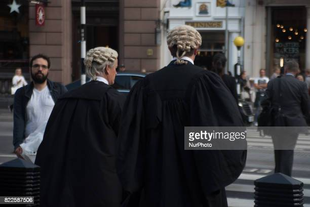 Lawyers are pictured outside The Royal Court Of Justice with their wigs London on July 25 2017 It has became the scene of the legal dispute about...