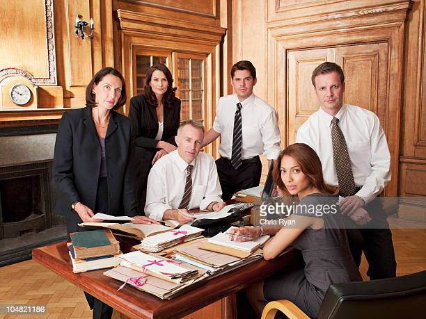Lawyers around desk in office