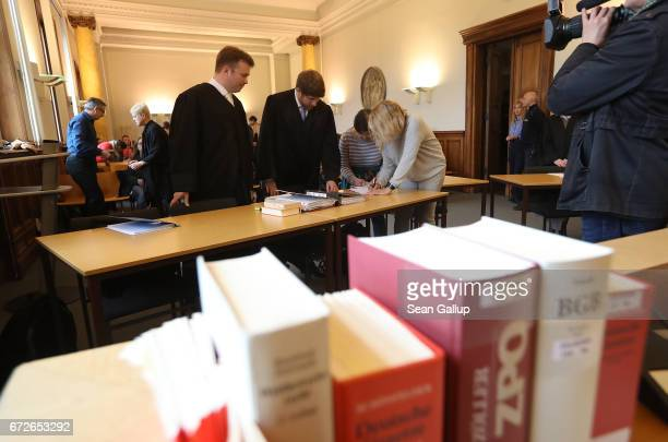 Lawyers arrive for the first day of a legal appeal by a woman against Facebook at the Kammergericht courthouse on April 25 2017 in Berlin Germany The...