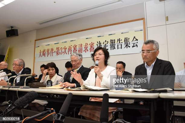 Lawyers attend a press conference after the Kagoshima District Court approved the retrial for Ayako Haraguchi who was convicted in the 1979 death of...