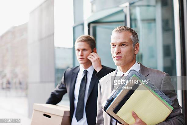 Lawyers carrying files and box