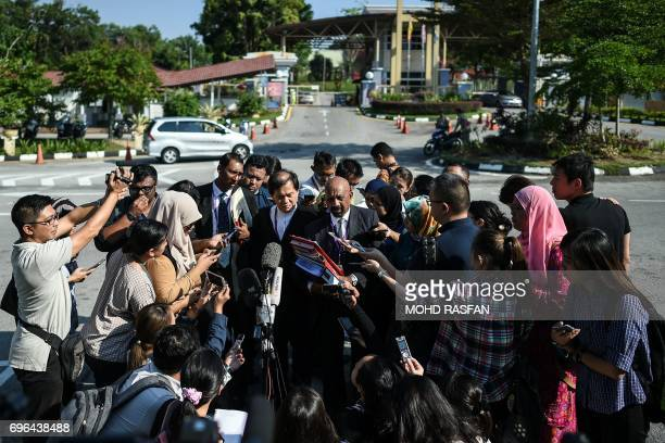 Lawyers for Vietnamese Doan Thi Huong speak to journalists after a pretrial procedure for the assassination of Kim JongNam the halfbrother of North...