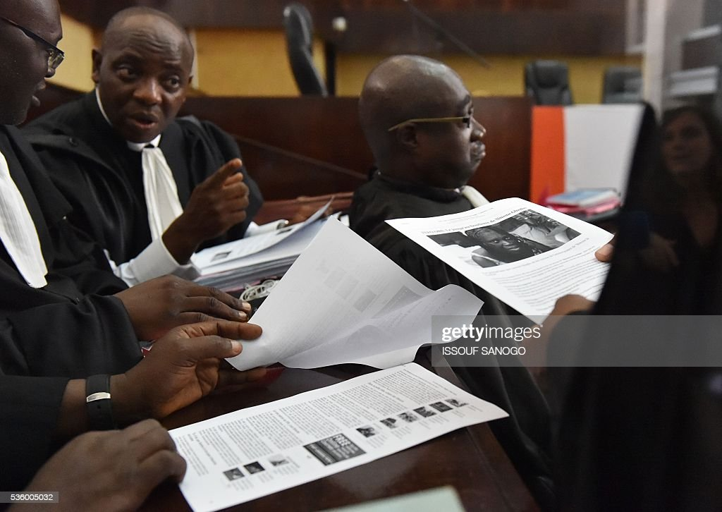 Lawyers of Ivory Coast's former first lady attend with documents during her trial on May 31, at the Abidjan Justice Court. Simone Gbagbo goes on trial for crimes against humanity in what many see as a litmus case for justice in the West African country. The hearings into the 66-year-old's role in post-election carnage in 2010 is expected to last a month with 32 witnesses testifying. SANOGO